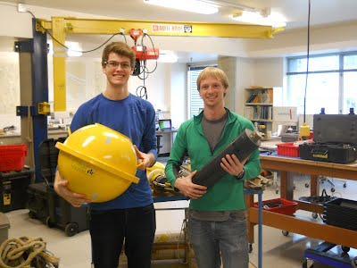 Derek (left) and Sam (right) with their favorite lab instruments.